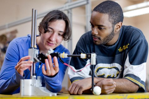 students in mechanical engineering working on project