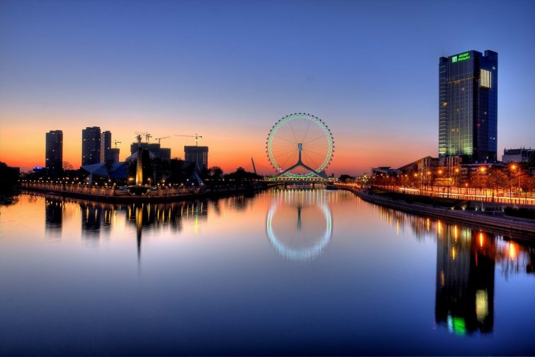 skyline view of the city of Tianjin in China at sunset